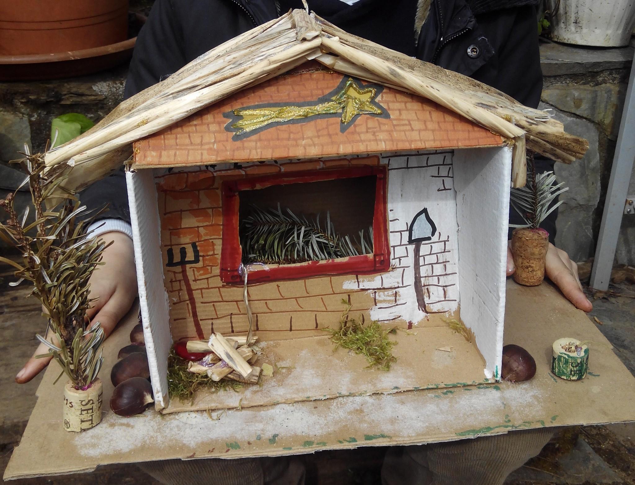 Un portal de Belén con la caja de huevo campero Pazo de Vilane