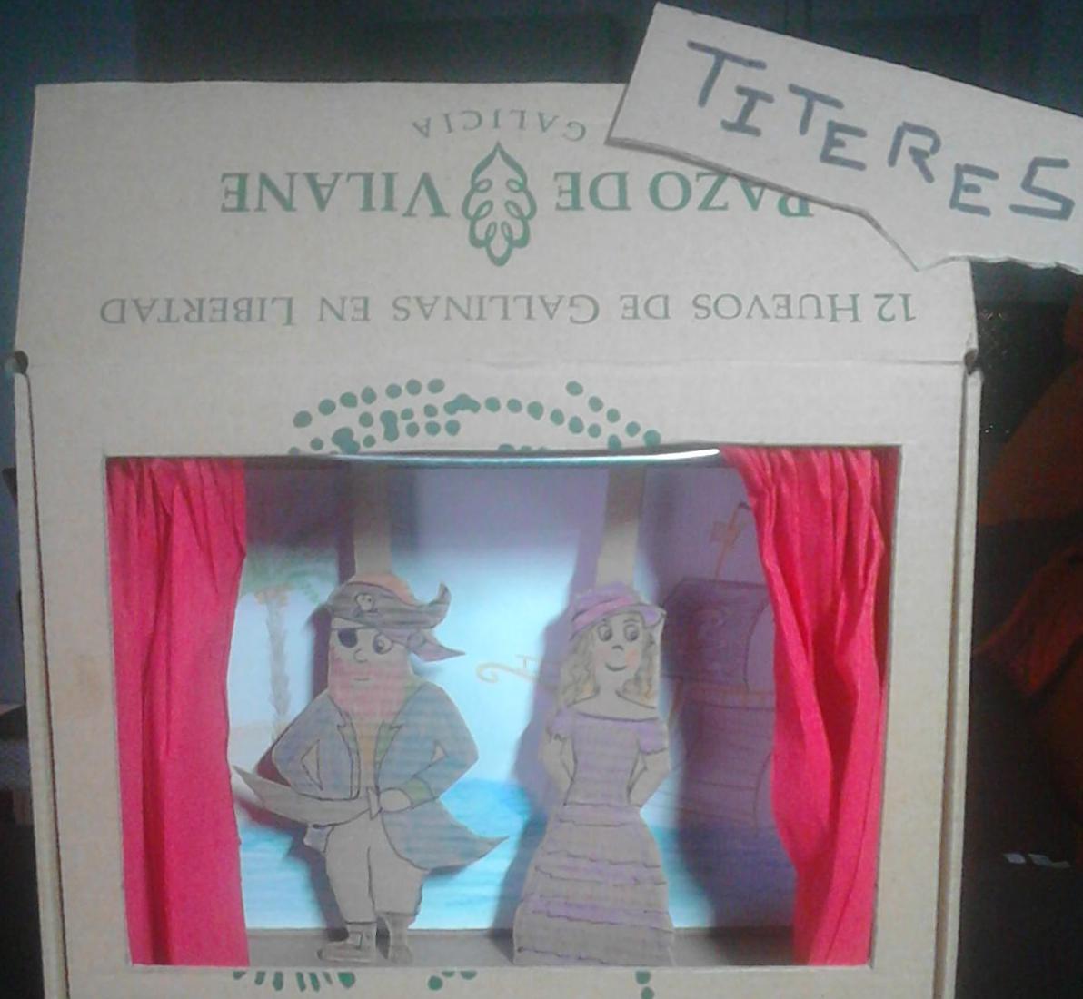 Un teatro de títeres fabricado con la caja de huevo campero Pazo de Vilane